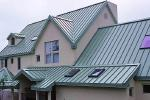 Teal metal roof installed by James Russell Roofing